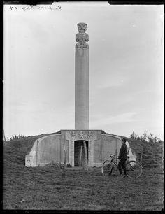 "The Kaiapohia Memorial or 'Tiki"" to the Ngai Tahu people with [Owen Williams?] and bicycle, Rangiora District, Canterbury Region Polynesian People, Maori Designs, Maori Art, Old Bikes, Canterbury, Underworld, New Zealand, Kai, Bicycle"