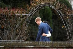 Prince Harry poses with Meghan Markle in the Sunken Garden of Kensington Palace. REUTERS/Toby Melville