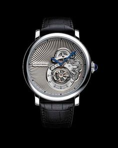 Rotonde de Cartier Reversed Tourbillon. White gold. Blue sapphire on the crown. $125K to get in the game.