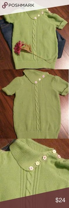 PRICE ✂ Girls green sweater This green cable sweater is so cute.  It has roll up short sleeves and an off set collar that opens by undoing the flowered buttons. The true color is closest to the first picture. It's a really pretty green. EUC Gymboree Shirts & Tops Sweaters