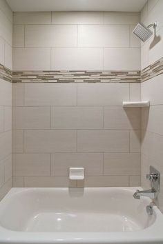 We Love Oversized Subway Tiles In This Bathroom! The Addition Of Glass  Accent Tiles Gives The Space A Custom Look Without Being Over The Top.