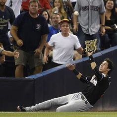 Sliding for an out - Christian Yelich of the Miami Marlins makes a sliding catch on a foul ball hit by Abraham Almonte of the San Diego Padres during the third inning July 23 in San Diego. Christian Yelich, Miami Marlins, The Outfield, San Diego Padres, Baseball Players, Ronaldo, Mlb, Seasons, Boys