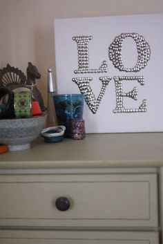 ..all you need is pushpins and a canvas! Could do names, initial, or even a silhouette.