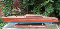 1930 Mahogany 34 ins Miss England boat matching period stand Bassett Lowke motor Electric Boat, Outdoor Tables, Outdoor Decor, Speed Boats, Tin Toys, Classic Toys, Vintage Toys, Pond, Period