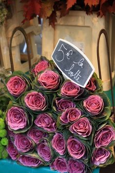 Paris market roses - every day I would go to the Marche' aux fleurs and pick out a rose or two.  One was peach-colored with lacy-edged petals.  Another was rich red inside and white on the outside.  I have since seen them here, but that was the first time I saw one.