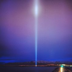 IMAGINE PEACE TOWER has relit tonight in Iceland for a week from 21-28 December! Watch live and send in your wishes for Peace at http://IMAGINEPEACETOWER.com #ImaginePeaceTower #ImaginePeace #Reykjavík #Wish #JohnLennon #Friðarsúlan #YokoOno #Iceland #Imagine #Viðey #cloud #sky #blue #pink #snow #peace