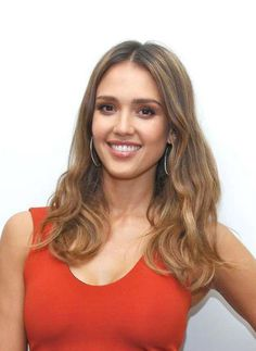 Jessica Alba looked stunning and radiant as she opted to dress up in an orange dress with a low cut neckline that teased a hint of her cleavage and curve hugging design, which highlighted her slender figure, while posing for pictures at the Mechanic: Resurrection press conference in Beverly Hills, Los Angeles on August 21, 2016. She was joined by her co-star Jason Statham at the event.