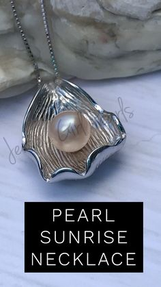 597327b2c96c Pearl sits front and center in a sterling silver shell. Any color pearl  would make