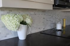 I'm loving this backsplash! It's Milky Way White Marble in the mosaic brick pattern from Olympia Tile