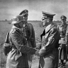 """Hitler meets with  SS-Obergruppenführer Sepp Dietrich, commanding the SS Liebstandarte Adofl Hitler division. Sepp, the former head of Hitler's SS bodyguard, was """"a friend from the old days"""" to whom Hitler felt a special attachment. Sepp proved himself a leader of men and a skilfful tactician. He fought to the very end, falling out with """"Adolf"""" only during the closing days of the war."""