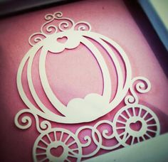 Framed princess carriage cut out attached to pink canvas background.