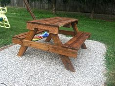 Mahogany Stained Picnic Table on White Pebbles