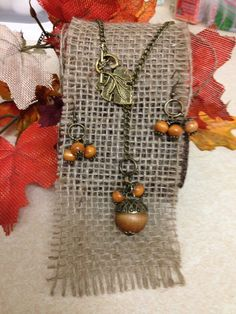 Mabon Autumn Antique Brass and Wood Acorn Necklace by CraftyOlBats