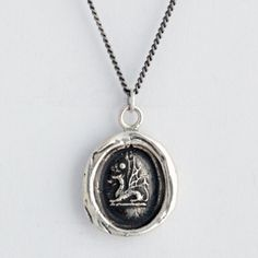 Protection Wax Seal Necklace    This handcrafted wax seal necklace features a dragon, a magical creature that has the power to see all things clearly. They are emblems of good fortune and protection.    Each Pyrrha talisman is cast in reclaimed sterling silver or bronze from a 19th century wax seal and is handcrafted in our studio in Vancouver, Canada.