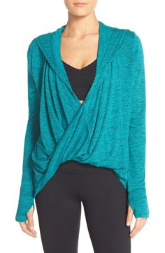 Head to the gym and beyond in this cozy cardigan from the Nordstrom Anniversary Sale! This Zella piece is fitted with a drapey wrap front and comfy long sleeves with thumbholes in the cuffs.