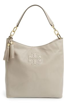 Pairing this gorgeous Tory Burch leather hobo with leggings, booties and a cozy turtleneck sweater dress.