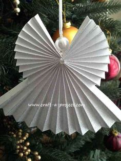 Create a Christmas Angel Ornament for your Xmas Tree this year using paper! Fun and easy activity for the kids.