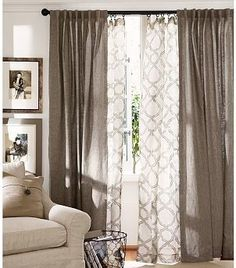 Good idea.. Sheer curtains to let light in, solid curtains to block light.