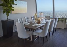 Walnut dining table and 8 white chairs in Luxury Los Angeles Penthouse in Ritz-Carlton Residences Wooden Floor Tiles, Wooden Flooring, Wood Floor, Interior Design Images, Interior Design Inspiration, Design Ideas, Wooden House Decoration, Walnut Dining Table, Dining Room Design