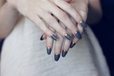 Matte slate blue nails with gold bed rims