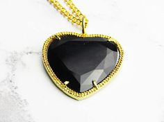 Black Heart Necklace, Black and Gold Necklace, Pendant Necklace, Glass Heart Pendant, Black Pendant Necklace, Gold Chain Necklace  I made this necklace with gold plated chain and a black glass heart pendant wrapped in a gold plated metal frame. This necklace is light comfortable to wear.