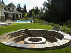 sunken patio with retaining wall seats and fire pit