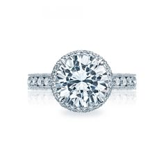 Style# HT2609RD10 - RoyalT - Engagement Rings - Tacori.com.  Perfect round + halo (it's not really a halo, Tacori's subtle version).  but need plain band, this is all over the top.