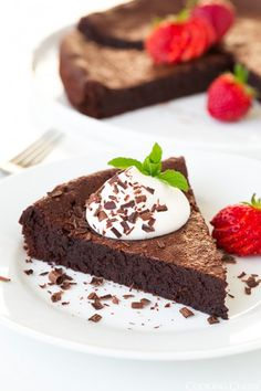 Flourless Chocolate Cake - This heavenly cake will likely remind you of a rich, decadent brownie yet it's texture is one all it's own. It's a texture that really does just melt away in your mouth. This cake can be served two ways, I tried the room temperature version and the chilled version and loved both. The chilled version reminded me more of the texture of a chewy brownie.