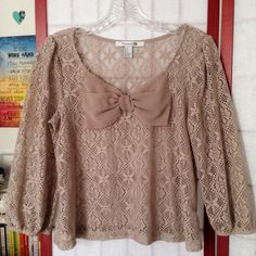 F21 chic beige mesh top w/ adorable bow Size: S • 100% polyester • Worn but in great condition • Very cute over a tank top or bandeau • Elastic arm openings • Originally purchased in Honolulu :) Forever 21 Tops Blouses