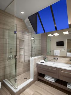 Bold skylight, and no matter what color the sky, it will always coordinate beautifully with the gray and white bathroom.