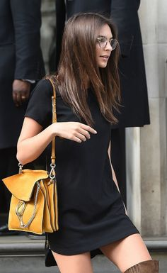 A black dress, a classic purse, and a over-the-knee boots make Emily Ratajkowski's look a great Fall look.
