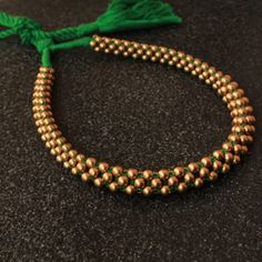 Handcrafted Green Thushi with adjustable thread.This necklace designed and artfully crafted with high gold polish with matte finishing. Jewelry Design Earrings, Gold Earrings Designs, Necklace Designs, Beaded Jewelry, Gold Choker Necklace, Beaded Necklace, Necklace Tattoo, Short Necklace, Gold Temple Jewellery