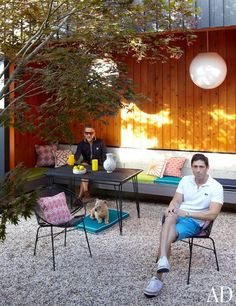 Doonan and Adler posed in their outdoor dining space.  Photo courtesy Architectural Digest and Joshua McHugh
