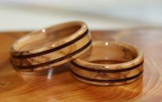 Bethlehem Olive Wood Wedding Rings with Black Walnut inlays commissioned by and created for Andrew and Liz.