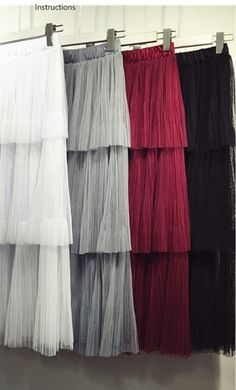 A tulle long maxi skirt with a ruffle tiered look and elastic waist that fits S-L available in black, wine, beige and grey