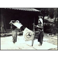 A photo of a young lady blowing the chaff from grain from T. Enami's collection of Japan life during the late 19th century and the beginning of the Meiji Restoration  #tenami #EnamiNobukuni #江南信國 #歴史 #日本 #幕府 #幕末 #将軍 #japan #japanesehistory #history #bakufu #bakumatsu #明治時代 #MeijiRestoration (by samurai_tamashii)