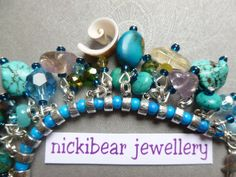 Gemstone charm bracelet.  Hippy Boho Pagan Seaside theme!  nickibear jewellery rtm Our signature style, created by nickibear - this one is stashed with high quality gemstones etc in seaside colours.  Available only from nickibear jewellery!