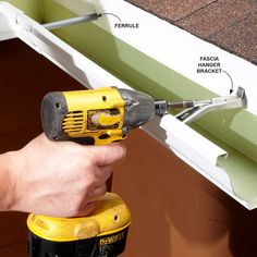 LOOSE GUTTER fix.  One way to make sure your gutter doesn't fall off the house is to install fascia hanger brackets. ...If your shingles overhang your fascia by a few inches or you have steel roofing, buy the brackets with the screws built in (the type shown here).|| #Gutter #Repair & Maintenance from familyhandyman.com