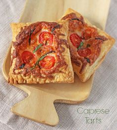These Caprese Tarts use light, flaky puff pastry to make a fresh, healthy and tasty snack or lunch for just 105 calories or 3 Weight Watchers points each! www.emilybites.com
