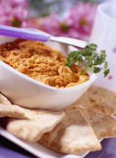 Sun Dried Tomato Hummus by Saad Fayed -  I have an old printout of an almost identical recipe by Saad, but it also calls for 2 TBSP of roasted garlic. For this recipe I save 2 TBSP of the drained chickpea liquid and use it in lieu of the olive oil, I use packaged sun dried tomatoes (soaking them in hot water for 10-15 minutes), and I add 1/4 tsp of salt.