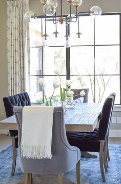 spring tour transitional dining room tulips on table velvet dining chairs kravet riad drapes-2