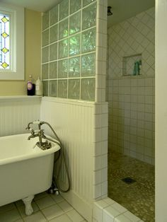 glass block shower with white tile; pin doesn't go directly to page of above project! so look at pic
