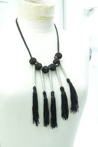 A unique macramé necklace from my winter collection with black cord (4mm), black tassels and silver tubes.
