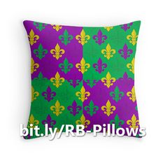 This colorful throw pillow features purple, green, and gold fleurs-de-lis (lily flowers) speckling a purple and green blocks background in a Mardi Gras themed pattern. http://www.redbubble.com/people/debidalio/works/12121560-mardi-gras-fleurs-de-lis?asc=u&p=throw-pillow #homedecor #bedding #festive #Redbubble #StudioDalio