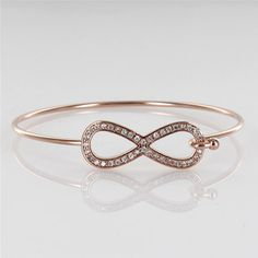 infinity rose gold bangle...awesome jewelry website