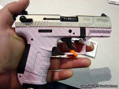 Walther P-22 pistol in pink camo finish.... I want this gun :)