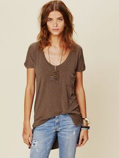 Free People We The Free Retro Stripe Tee, $58.00, Retro striped basic tee with one front pocket and scoop neckline. Slight high low hem. Sleeve hems are raw edge and cuffed. Each bottom side has a slit.     We the Free brings us back to our down-to-earth, All-American roots, made mostly with casual cottons that have a lightly distressed and perfectly worn in feel.