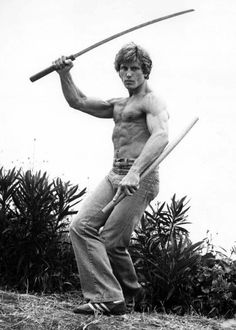 Joe Lewis...the Karate Legend....this man had the abs of pain in fact look at that face and body and stop asking why I put this here lol!