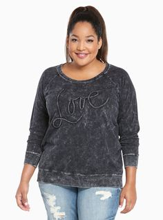 """The ultimate lazy style - the sweatshirt - gets the rock 'n' roll upgrade it deserves. Feel like you're chillin' on the couch with the soft and stretchy grey knit. Look like you're going to a concert with the 80's inspired mineral wash. Spread the """"love"""" with vintage-inspired embroidery.<div><br></div><div><b>Model is 5'10"""", size 1<br></b><div><ul><li style=""""LIST-..."""