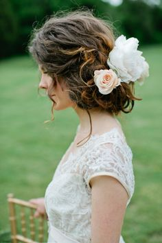 Bride with Flowers in Hair | photography by http://www.kristynhogan.com/